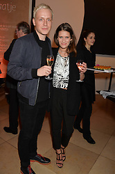 MR HUDSON and HOLLY GRACE at a private view of photographs by David Bailey entitled 'Bailey's Stardust' at the National Portrait Gallery, St.Martin's Place, London on 3rd February 2014.