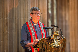 © Licensed to London News Pictures. 19/07/2019; Bristol, UK. Extinction Rebellion Summer Uprising 2019. REV DAN TYNDALL, Vicar of St Mary Redcliffe, reads from the Book of Revelation at an Extinction Rebellion event in St Mary Redcliffe church on the last day of the week's protest with readings from the Bible's Book of Revelation by the Reverend Dan Tyndall Vicar of St Mary Redcliffe, and other clergy and members of Extinction Rebellion. Extinction Rebellion are holding a five-day 'occupation' of Bristol, by occupying Bristol Bridge in the city centre and traffic has to be diverted and carrying out other events. As part of a country-wide rebellion called Summer Uprising, followers will be holding protests in five cities across the UK including Bristol on the theme of water and rising sea levels, which is the group's focus for the South West. The campaign wants the Government to change its recently-set target for zero carbon emissions from 2050 to 2025. Photo credit: Simon Chapman/LNP.
