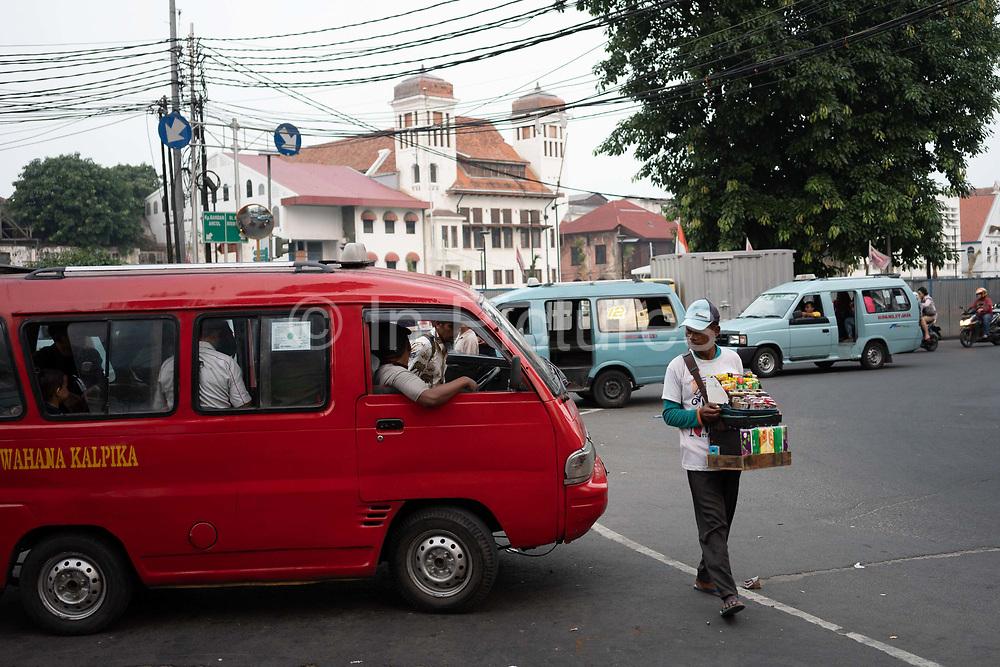 Road with vehicles and street vendor near Kota Intan bridge chicken market bridge on 8th June 2018, Jakarta, Java, Indonesia.