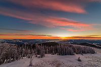 The views at sunrise were stunning from the Granite Butte fire lookout on Montana's continental divide. All the whitebark pine trees were coated with thick rime ice and fog drifted around the valleys. I had to use my widest lens to capture all the color.