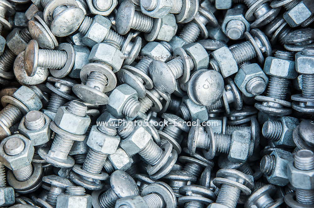 A stack of screws, nuts and bolts