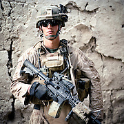 """Location:<br /> Patrol Base Fires, Sangin District, Helmand Province, Afghanistan<br /> <br /> Unit: <br /> 3rd Squad, 1st Platoon, Bravo Company, 1st Battalion, 5th Marines<br /> <br /> Name and Rank: Sergeant Jarick Fry<br /> <br /> Age: 24<br /> <br /> Hometown: Irwin, Pennsylvania<br /> <br /> Interview selections:<br /> <br /> Explain how you volunteered to be a combat replacement:<br /> <br /> """"The opportunity arose probably about a week and a half prior to me actually deploying. I heard 1/5 had some casualties and they needed some sergeants over here, some guys with some experience to help make it through the rest of the deployment. So as soon as I heard the word I started beating on doors to get over here, 'cause that's all I've wanted to do since I've been in.""""<br /> <br /> What did your wife think of your decision to volunteer?<br /> <br /> """"My wife and my friends didn't want me to come, but none of 'em would tell me different because of me being a Marine and me being who I am, they knew that no matter what they said I was still gonna come, so they were all just very supportive after I told 'em I was coming'.""""<br /> <br /> What do you make of the Taliban in terms of their tactics?<br /> <br /> """"The Taliban fighters that we're fighting now are all young, it's none of the old fighters anymore. Whether they were killed or they just left the AO because they were being overrun by coalition forces. They're cowards. They don't stay and fight. If they see the opportunity—if we give them the opportunity to attack us—they will attack us, but as long as everybody's guard's up 100% of the time and we use proper tactics, the enemy . . . doesn't even wanna fight anymore.""""<br /> <br /> What's the responsibility of being squad leader like?<br /> <br /> """"The billet of squad leader carries a lot of weight. Not only are you charged with . . . in charge of thousands and thousands of dollars of equipment and ammunition, but you're in charge of ten other Marines' lives. You hon"""