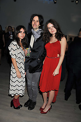 PIERS JACKSON and his daughters, left to right, ASSISI JACKSON and AMBA JACKSON at Arts for Human Rights gala dinner in aid of The Bianca Jagger Human Rights Foundation in association with Swarovski held at Phillips de Pury & Company, Howick Place, London on 13th October 2011.