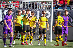 July 22, 2018 - Charlotte, North Carolina, USA - Borussia Dortmund players congratulate Borussia Dortmund midfielder Christian Pulisic (22) after a goal during an International Champions Cup match at Bank of America Stadium in Charlotte, NC.  Borussia Dortmund of the German Bundesliga beat Liverpool of the English Premier League 3 to 1. (Credit Image: © Jason Walle via ZUMA Wire)
