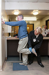 Defendant being searched by court staff