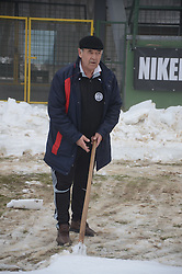 Slobodan Djuric, coach of ND Mura 05 is cleaning the snow two days before match between ND Mura 05 and NK Olimpija in 22th Round of Prva liga NZS 2012/13, on March 1, 2013 in Fazanerija, Murska Sobota, Slovenia. (Photo by Ales Cipot / Sportida)