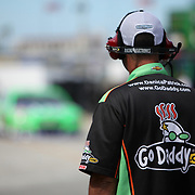 A pit crew member waits near the garage area for NASCAR Sprint Cup driver Danica Patrick (10) to pull in during the NASCAR Coke Zero 400 Sprint practice session at the Daytona International Speedway on Thursday, July 4, 2013 in Daytona Beach, Florida.  (AP Photo/Alex Menendez)