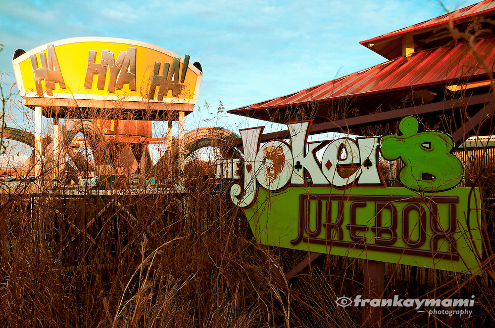 Photo of The Joker's Jukebox ride in ruins at the abandoned Six Flags themepark in New Orleans.
