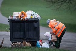 © Licensed to London News Pictures. 05/04/2021. London, UK. Litter overflowing form a bin on Primrose Hill in north London, the morning after revellers took to the picturesque location to enjoy the warm spring weather. A relaxation of some lockdown restrictions has gathered larger crowds in many outdoor spaces. Photo credit: Ben Cawthra/LNP