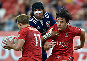 USA's Andrew Durutalo competes with Canada's Harry Jones and Nathan Hirayama during the HSBC World Rugby Sevens Series - Singapore match USA-V-Canada - Cup Final at The National Stadium, , , Singapore on Sunday, April 16, 2017. (Steve Flynn/Image of Sport)