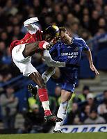 Photo: Olly Greenwood.<br />Chelsea v Arsenal. The Barclays Premiership. 10/12/2006. Chelsea's John Terry and Arsenal's Emmanuel Adebayor