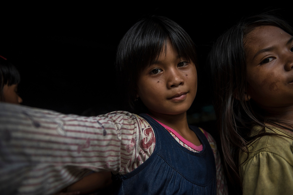 South Kalimantan, Indonesia - February 28, 2017: Girls in the village of Loklahung, in Indonesia's South Kalimantan province, on the island of Borneo.
