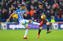 Huddersfield Town's Tommy Smith (left) and Arsenal's Sead Kolasinac battle for the ball during the Premier League match at the John Smith's Stadium, Huddersfield.