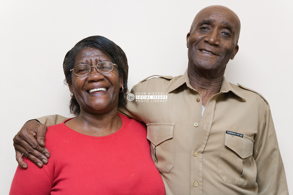 Older couple laughing and embracing one another,