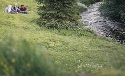 THEMENBILD - eine Gruppe von arabischen Touristen sitzen direkt am Bach und machen ein Picknick. Hintersee ist ein kleiner Gebirgssee in 1313 m Höhe im Talschluss des Felbertals in Mittersill. Der Bergsee ist ein Naturdenkmal und wurde unter Schutz gestellt. Der Hintersee gilt als Geheimtipp, Erholungsgebiet und ein Platz, den man gesehen haben muss, aufgenommen am 23. Juni 2019, am Hintersee in Mittersill, Österreich // a group of Arab tourists sitting right by the creek having a picnic. Hintersee is a small mountain lake 1313 m above sea level at the end of the Felbertal valley in Mittersill. The mountain lake is a natural monument and was placed under protection. The Hintersee is an insider tip, a place you must have seen and a recreation area on 2019/06/23, Hintersee in Mittersill, Austria. EXPA Pictures © 2019, PhotoCredit: EXPA/ Stefanie Oberhauser