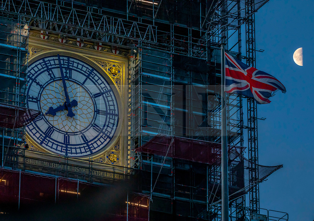 © Licensed to London News Pictures. 17/01/2020. London, UK. The moon looking down at Big Ben as confusion remains as to whether Big Ben will bong or not bong for Brexit after MP's decided the £500,000 cost was too high. Several MPs had asked for the bell to ring on 31 January 2020 to mark the UK's departure from the EU. £150,000 has already be donated by the public but the donation has apparently been rejected by the House of Commons Commission. Photo credit: Alex Lentati/LNP