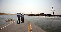 www.shawnrocco.com<br /> www.cellularobscura.com<br /> 919-812-8291<br /> shawnrocco@gmail.com<br /> <br /> <br /> NCDOT officials walk along a washed out section of N.C. 12 about 8-miles south of the Bonner Bridge in the Pea Island National Wildlife Refuge on Monday, August 29, 2011. They came down to assess the numerous breaches caused by Hurricane Irene.