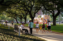 Stock photo of people enjoying the park's benches and walking paths