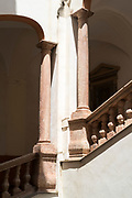 Typical Sicilian ornate palazzo architecture with marble columns and balustrades of staircase in Palermo, Sicily, Italy