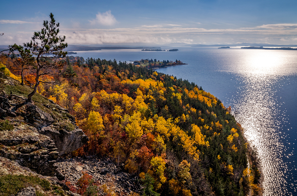 Mt. Kineo, with 700-foot (210 m) cliffs rising straight up from the water of Moosehead Lake.  <br />  It is a peculiar geological formation of flint as well as the country's largest mass of this rock.