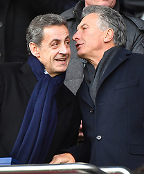 Former French President Nicolas Sarkozy and Argentina's President Mauricio Macri watch from the stands the Ligue 1 Paris Saint-Germain (PSG) v Montpellier football match at the Parc des Princes stadium in Paris, France, January 27, 2018. Photo by Christin Liewig/ABACAPRESS.COM