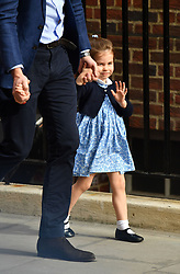 Princess Charlotte holds her fathers hand as she arrives to meet her newborn brother at the Lindo Wing at St Mary's Hospital in Paddington, London.
