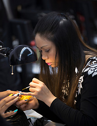 Tammy Cao, a licensed beautician in Alameda, Calif., paints the nails of a client at Tulip Nails on Wednesday, April 26, 2017. (Photo by D. Ross Cameron)