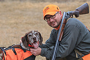 Bob St. Pierre takes a break with his German Shorthair, Tram, during a late season hunt in Minnesota