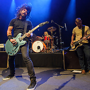 "WASHINGTON, DC - May 5th, 2014 - Dave Grohl, Taylor Hawkins and Nate Mendel of the Foo Fighters perform at the 9:30 Club in Washington D.C. as part of the birthday celebration for Big Tony of Trouble Funk.  The band performed as surprise guests and played a set full of hits such as ""My Hero"" and ""These Days."" (Photo by Kyle Gustafson / For The Washington Post)"