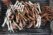 Chicken feet BBQ<br /> Calpi animal market<br /> Parish of Riobamba, Chimborazo Province<br /> Andes<br /> ECUADOR, South America