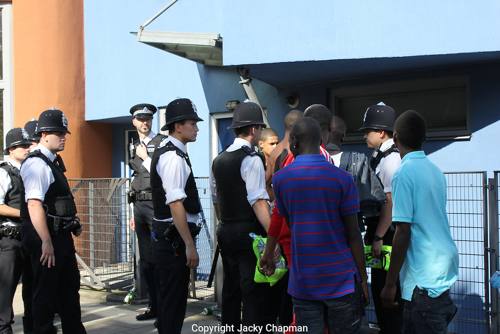 Police stopping youths for questioning during Notting Hill Carnival