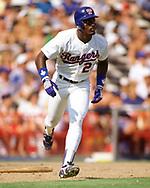 ARLINGTON - 1988:  Ruben Sierra of the Texas Rangers bats during an MLB game at Arlington Stadium in Arlington, Texas during the 1988 season. (Photo by Ron Vesely) Subject:   Ruben Sierra