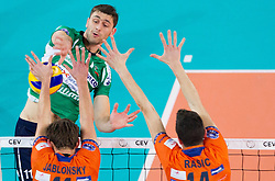 Tsvetan Sokolov of Cuneo vs Jayson Jablonsky of ACH and Milan Rasic of ACH during volleyball match between ACH Volley Ljubljana and Bre Banca Lannutti Cuneo (ITA) in Playoff 12 game of CEV Champions League 2012/13 on January 15, 2013 in Arena Stozice, Ljubljana, Slovenia. (Photo By Vid Ponikvar / Sportida.com)