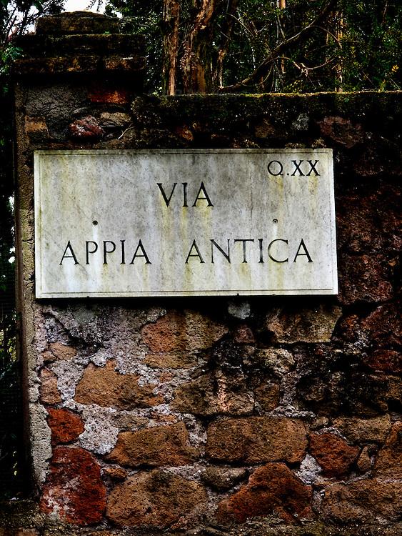 Sign inscription plaque on brick wall Via Appia Antica