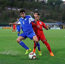 Alex Oxlade-Chamberlain of England (Arsenal) battles for the ball with Nicola Chiaruzzi of San Marino (SP Tre Penne)  - Mandatory byline: Joe Meredith/JMP - 07966386802 - 05/09/2015 - FOOTBALL- INTERNATIONAL - San Marino Stadium - Serravalle - San Marino v England - UEFA EURO Qualifers Group Stage