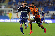 Cardiff City's Joe Mason goes past Wolves' Ethan Ebanks-Landell. Skybet football league championship match, Cardiff city v Wolverhampton Wanderers at the Cardiff city stadium in Cardiff, South Wales on Saturday 22nd August 2015.<br /> pic by Carl Robertson, Andrew Orchard sports photography.