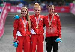 England's Evie Richards (silver), Annie Last (gold) and Canada's Haley Smith (Bronze) with their medals after the Women's Cross-country at the Nerang Mountain Bike Trails during day eight of the 2018 Commonwealth Games in the Gold Coast, Australia.