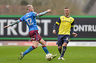 Scunthorpe United Midfielder, Neal Bishop (12) and Oxford United Defender, Joe Skarz (3) during the EFL Sky Bet League 1 match between Oxford United and Scunthorpe United at the Kassam Stadium, Oxford, England on 18 March 2017. Photo by Adam Rivers.