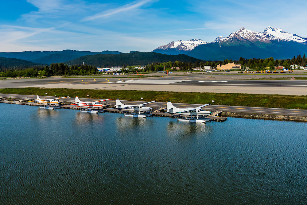 Taking off in a float plane from Juneau International Airport, Juneau, Alaska USA.