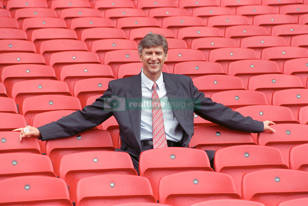 NEW ARSENAL BOSS ARSENE WENGER SITS IN THE STANDS AFTER TAKING OVER THE HOT SEAT AT Highbury. THE 47-YEAR-OLD REVEALED HOW HE WAS TEMPTED TO JOIN WITH HIS OLD PROTEGE GLENN HODDLE AS THE FA'S NEW TECHICAL DIRECTOR BEFORE ACCEPTING THE CHALLENGE FROM GUNNERS.