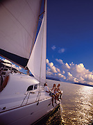 A family of four relaxes on a yacht in the carribean waters of British Virgin Islands