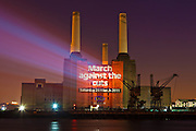 Battersea Power Station. PCS Union projected some of London main building with anti cut slogans and encouraged people to attend the March.