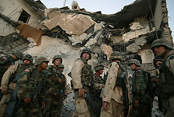 U.S. soldiers from the 203rd Engineers within the 1st AD prepare to comb the site of the explosion  at the Canal Hotel for bodies Aug. 21, 2003 in Baghdad, Iraq. The previous day a cement truck packed with explosives detonated outside the offices of the UN headquarters in Baghdad, Iraq, killing 20 people and devastating the facility in an unprecedented suicide attack against the world body. At least 100 people were wounded.