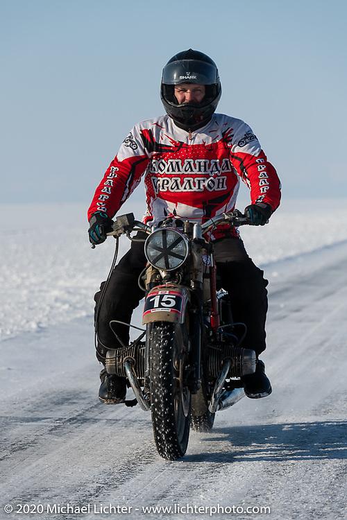 Team Uralgon's Vasliy Yurin on his Ural ice racer at the Baikal Mile Ice Speed Festival. Maksimiha, Siberia, Russia. Friday, February 28, 2020. Photography ©2020 Michael Lichter.