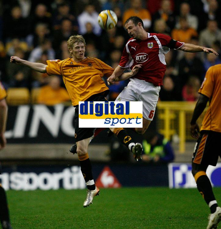 Photo: Steve Bond/Sportsbeat Images.<br /> Wolverhampton Wanderers v Bristol City. Coca Cola Championship. 03/11/2007. Louis Carey  (R) wins the ball in the air