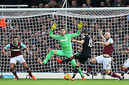 Marco van Ginkel of Stoke City takes a shot at goal but sees it blocked as Adrian , the West Ham goalkeeper spreads himself wide.. Barclays Premier league match, West Ham Utd v Stoke city at the Boleyn Ground, Upton Park  in London on Saturday 12th December 2015.<br /> pic by John Patrick Fletcher, Andrew Orchard sports photography.