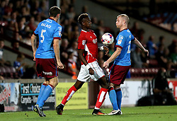 Tammy Abraham of Bristol City challenges Neil Bishop of Scunthorpe United to the ball - Mandatory by-line: Robbie Stephenson/JMP - 23/08/2016 - FOOTBALL - Glanford Park - Scunthorpe, England - Scunthorpe United v Bristol City - EFL Cup second round