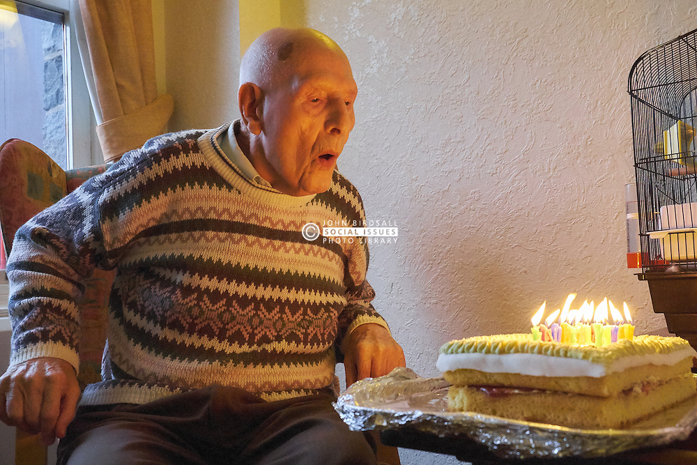 94 year old man celebrating his birthday in residential home. MR
