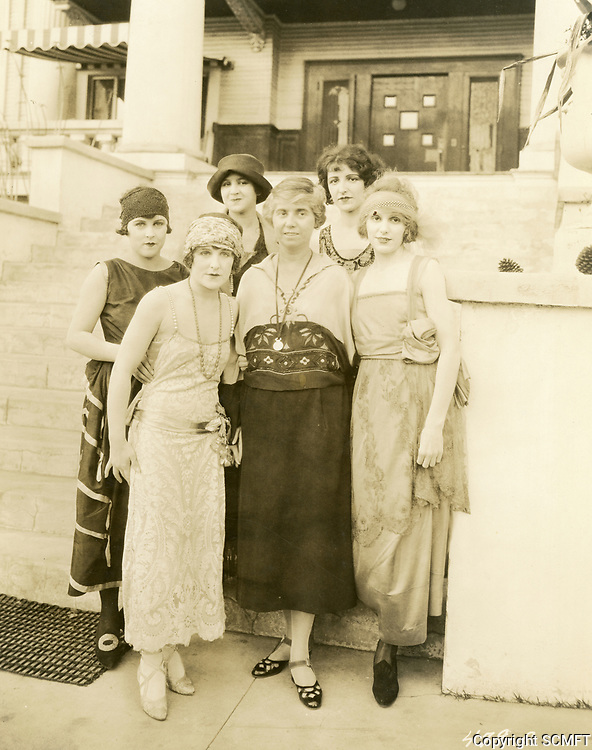 1920 Marjorie Williams (center), director of the Hollywood Studio Club, stands with girls at Carlos Ave. clubhouse