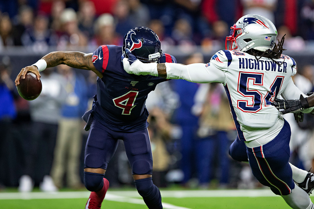 HOUSTON, TX - DECEMBER 1:  Deshaun Watson #4 of the Houston Texans avoids the rush of Dont'a Hightower #54 of the New England Patriots during the first half at NRG Stadium on December 1, 2019 in Houston, Texas.  The Texans defeated the Patriots 28-22.  (Photo by Wesley Hitt/Getty Images) *** Local Caption *** Deshaun Watson; Dont'a Hightower